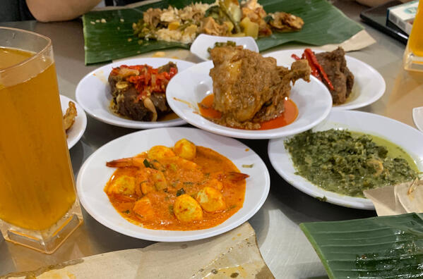 Image shows a variety of traditional indonesian dishes
