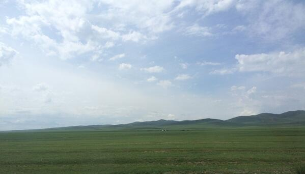Image showing a view of vast green land and clear blue sky