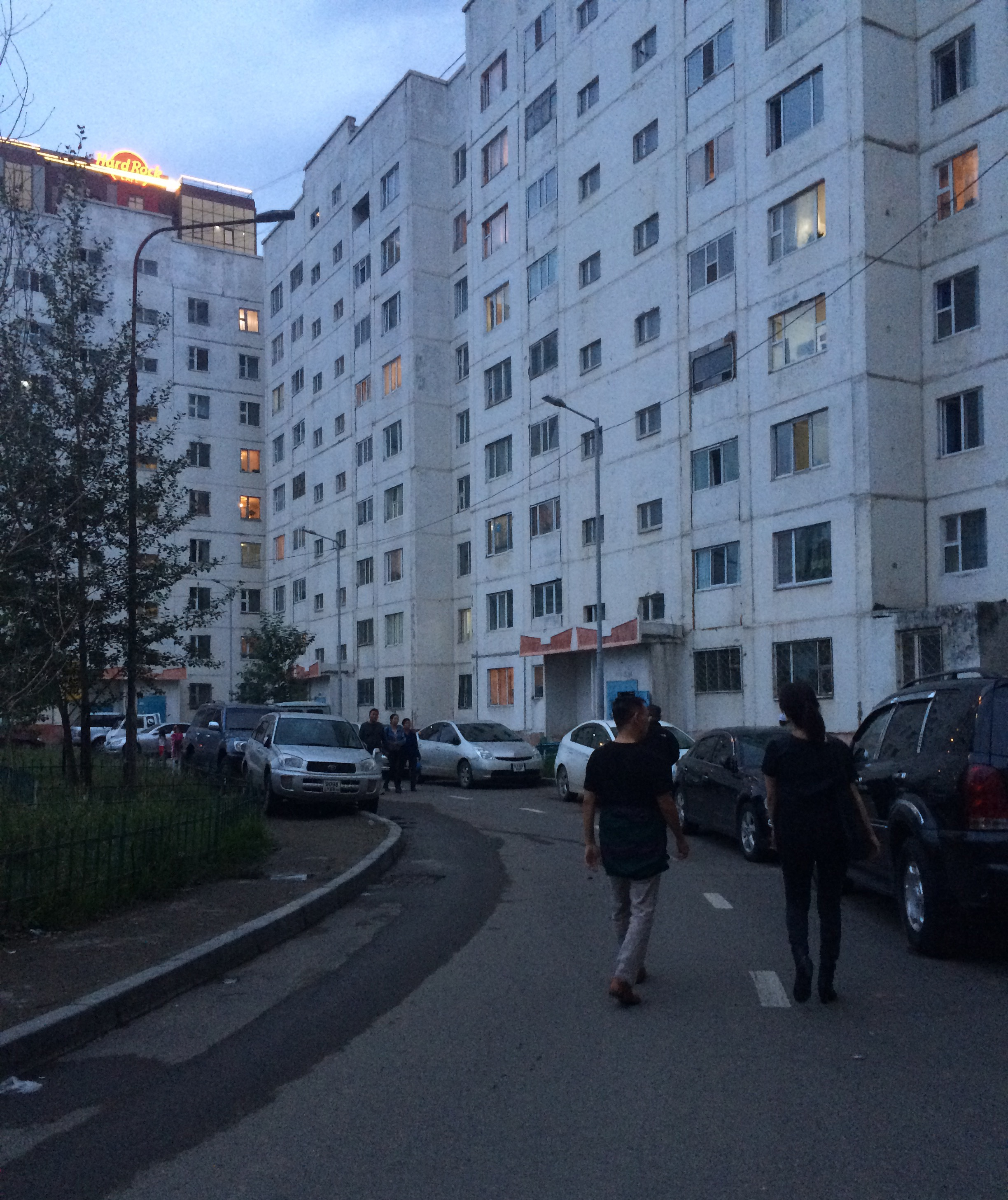 Image shows the street view of apartment blocks in the city of Ulaanbaatar