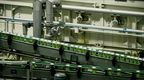 Image shows the parallel view of the coca-cola conveyor system